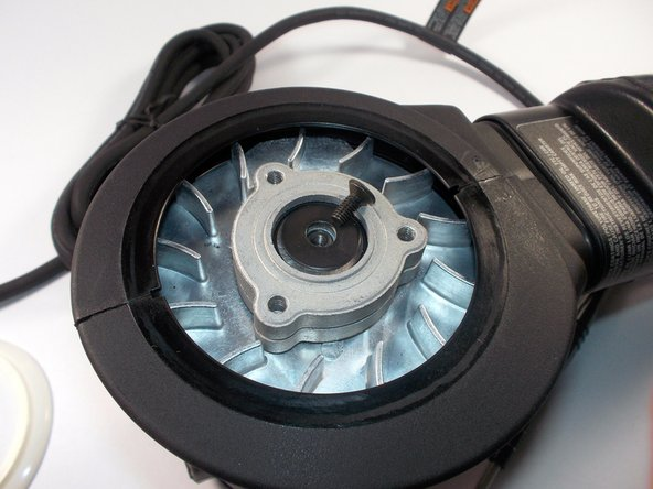 Once the dust brake/ seal is removed locate the screw in the center of the device holding down the bearing and fan assembly.