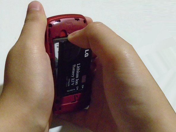 Use your thumb to pop out the battery.