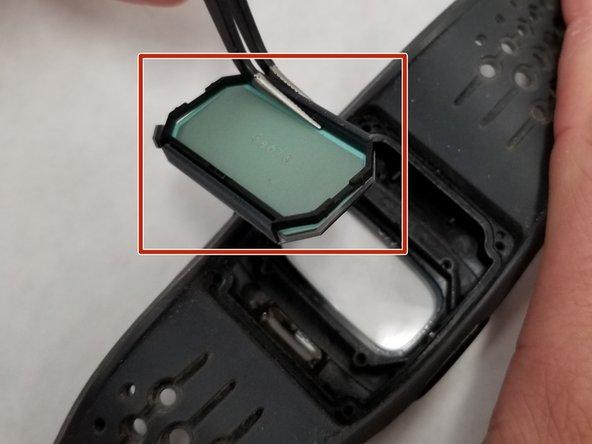 Remove the screen using tweezers.