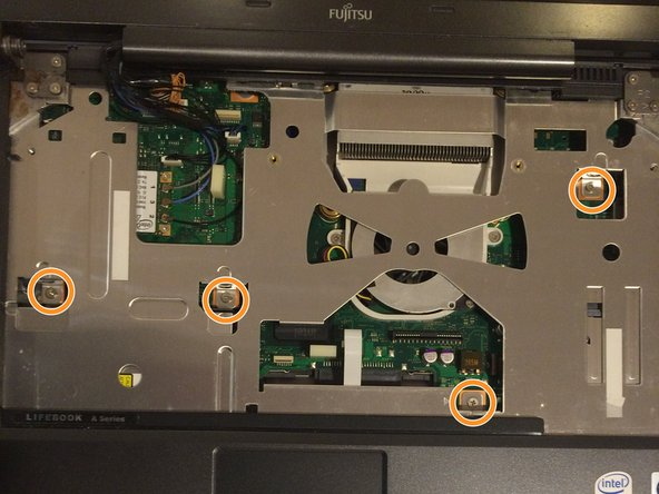 Using a Phillips #1 screwdriver, remove the four 6 mm screws located around the motherboard.
