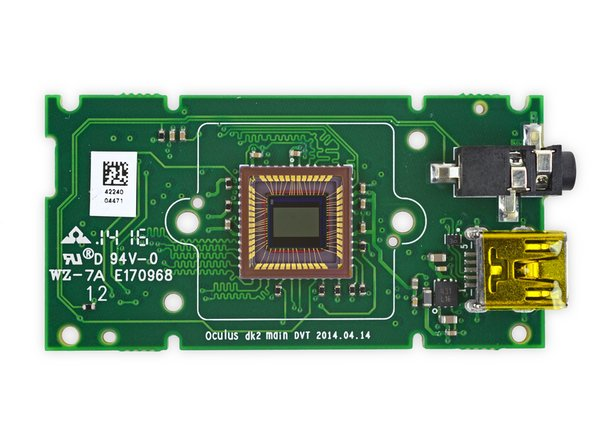 Upon freeing this baby motherboard from its enclosure, we spy the positional camera's CMOS image sensor.