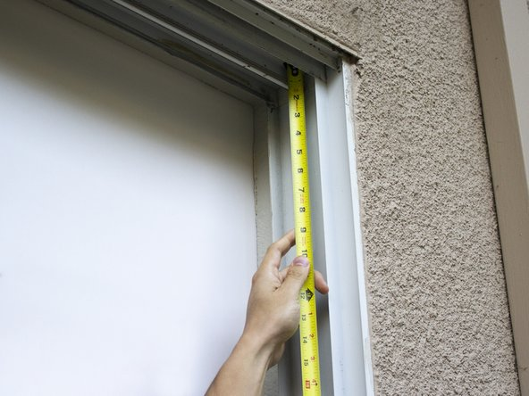 Measure the height of the sliding glass door frame.