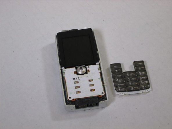 Image 2/3: These are all of the parts covered in this disassembly that make up the Sony Ericsson QuickShare T630.