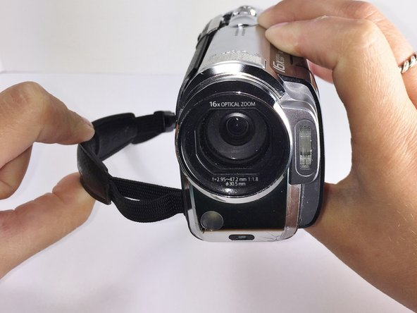 When the side cover is securely fastened, you have completed the hand-strap replacement of your Panasonic HDC-TM15 camcorder.