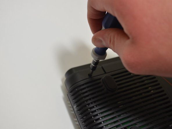Unscrew the five 10-mm screws on the bottom of the router using a Phillips #0 screwdriver.