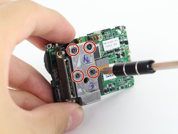 Using the T4 Torx toolbit, remove the 4 screws that connect the sensor to the lens.
