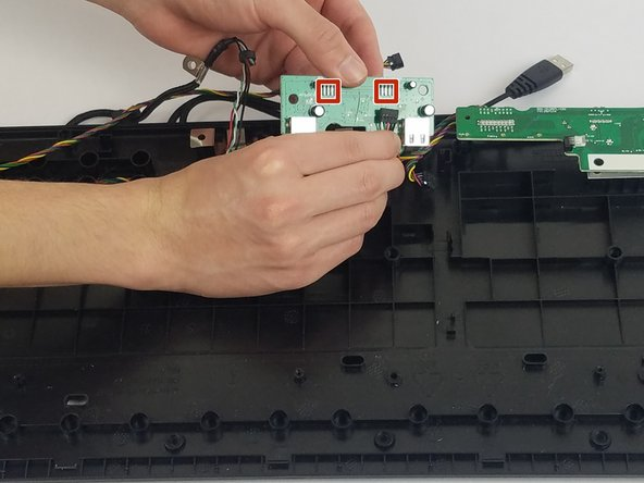 Unplug the wires and remove the USB port connector.