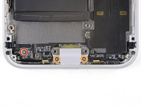 Remove the three screws securing the Lightning connector cable in place: