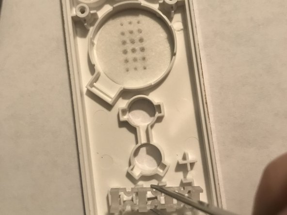 To have this be a complete teardown, there's also this small piece at the bottom where the four lights would light up telling you if you're player 1,2,3 or 4. You don't realllly need to remove this piece but if you want to be thorough then go ahead.