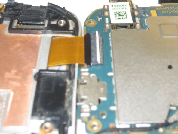 Remove the gold ribbon cable by lifting tab at the back of the socket, using a spudger or tweezers.
