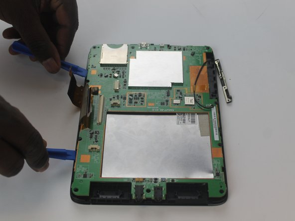 use openning tools to remove the motherboard.