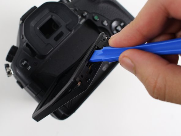 Use a plastic opening tool to pry open the plastic screen casing. It might be easiest to start prying near the screen mount, and then work your way around the casing.