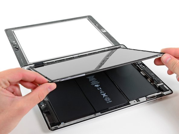 Image 1/2: Be very careful when moving the LCD, and do not attempt to remove it from the iPad—its display data cable will remain connected while it is rotated over.