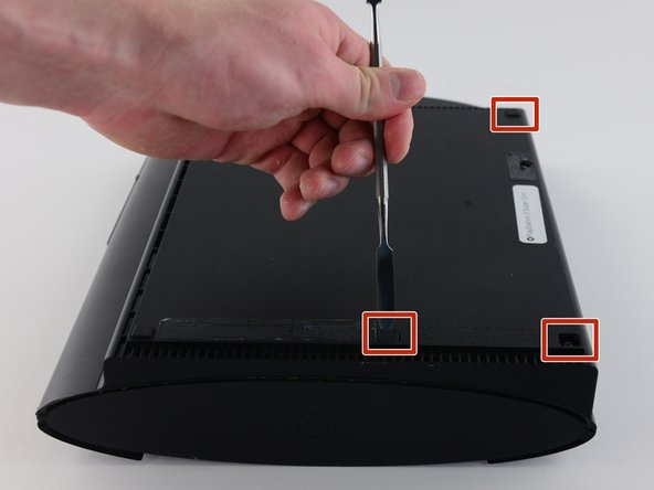 Image 1/2: Remove the four black 36.3mm long screws underneath with a Phillips #1 screwdriver.