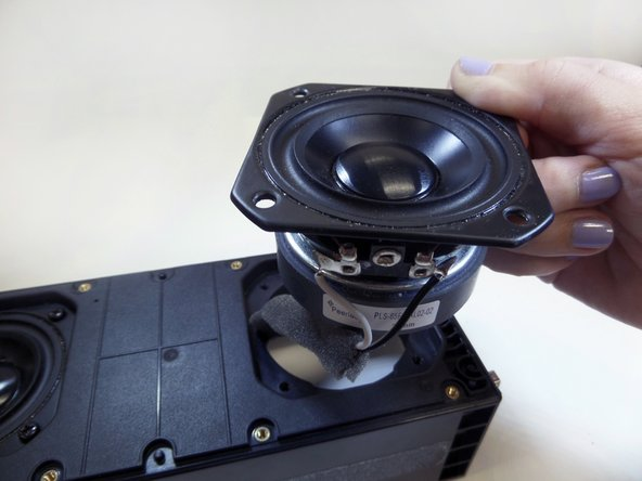 Image 3/3: Remove the speakers with your hands and replace with new ones.