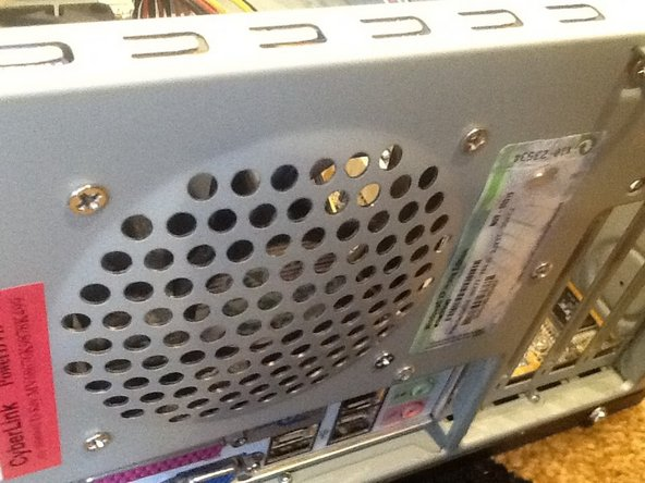 Remove the four screws securing the back fan. Disconnect the cable