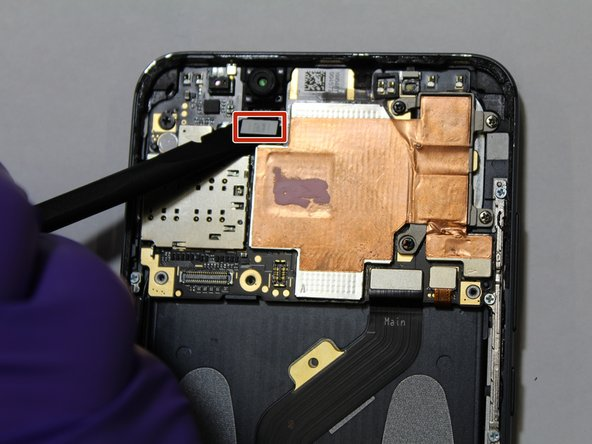 Using a plastic spudger, gently separate the front camera ribbon cable from the motherboard.