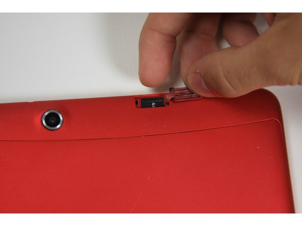 Once the card pops out, use your finger to pull the card completely out of the SD card slot.