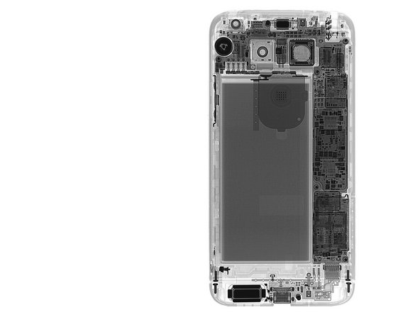Image 2/3: Small metal backing in the center of the phone, ~~logic~~motherboard stage right, battery at center left—could it be phone Feng Shui?