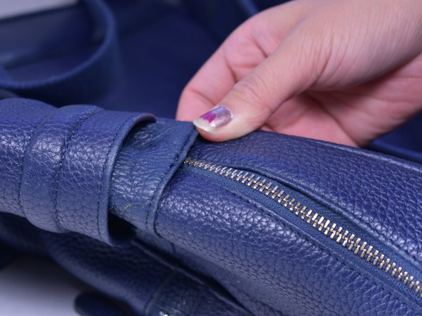 Image 2/2: Sew the zipper fabric to the backpack to secure it in place.