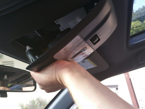 Remove the plastic covering of the lights by pulling it down quickly from the windshield side.