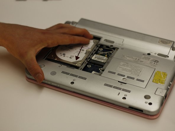 Apply firm pressure to secure the new hard drive into the old hard drive's location.