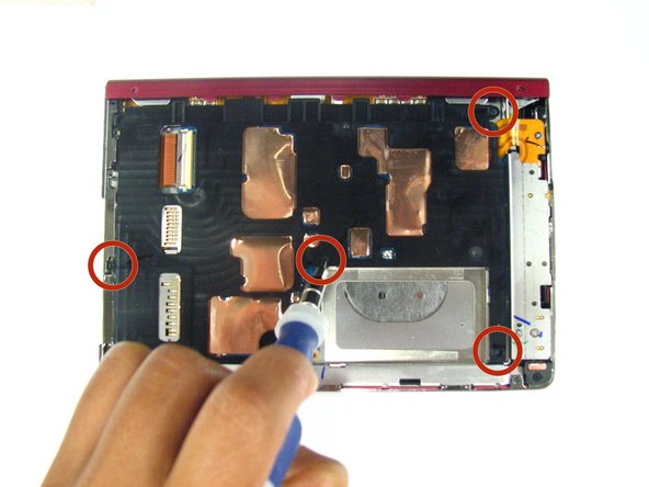 Using a screwdriver remove the four 1.4 mm screws that are holding the black plastic casing in place.
