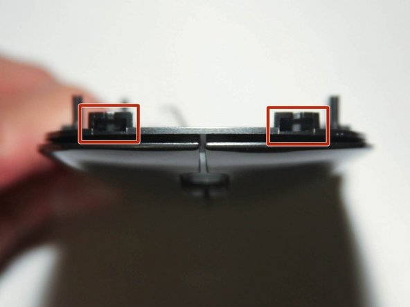 In order to remove the mouse cover, you will need to rock left/right the cover and slide it down (from scroll wheel toward the Lenovo logo)