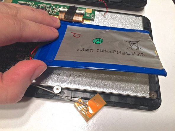 The old battery is attached to the back of the screen by adhesive double sided tape. This means you will have to peal the battery from the surface. A putty knife will be needed to get under the battery.