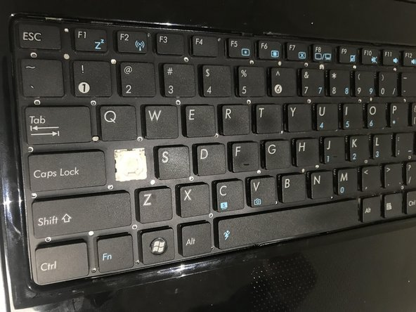 Use your finger to gently pull up on individual keys until they pop off.