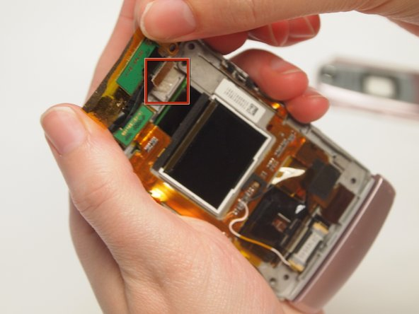 Use a spudger to detach all of the connections to the motherboard in the back of the phone by the screen.