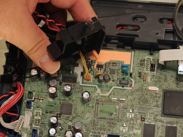 Lift the cover away from the motherboard and set is aside.