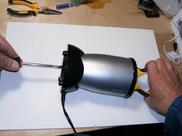 To remove the blade gear, turn the Magic Bullet on its side and use a flat tip screw driver on the bottom end, and the pliers on the base gear. Turn the blade gear in clock wise direction to remove it off the shaft.