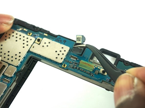 Carefully detach the camera using the precision tweezers.