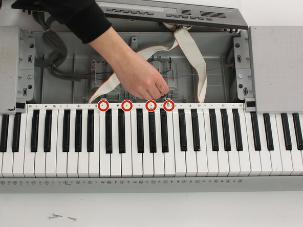 Image 1/3: Gently push white keys away from screws and pull up to remove from keyboard. Repeat this with the black keys