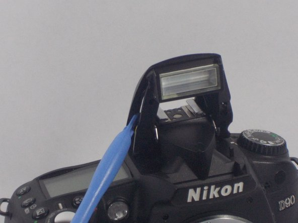 Image 1/3: Then, lift off the top casing of the flash.