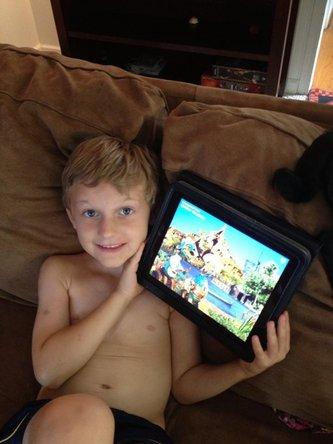 Boy doing iPad repair at iPad Rehab