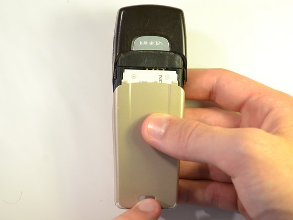 Slide the back of the phone downwards and away from the main body.