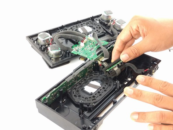 Remove the two 12.5 mm screws on either side of the charging port using a Torx T10 screwdriver.