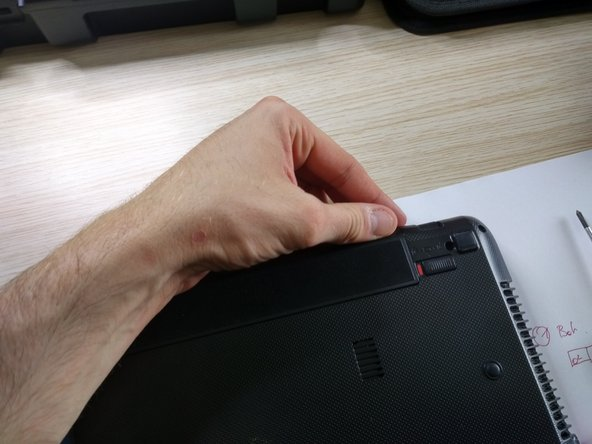 remove battery by sliding the two release buttons to the right position.