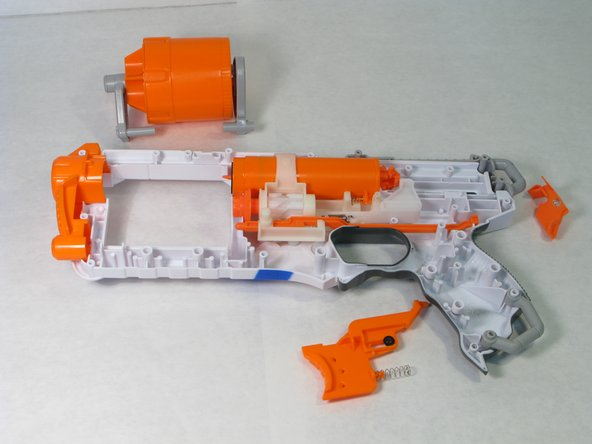 Place the spring chamber and the Nerf bullet cylinder back into the base.