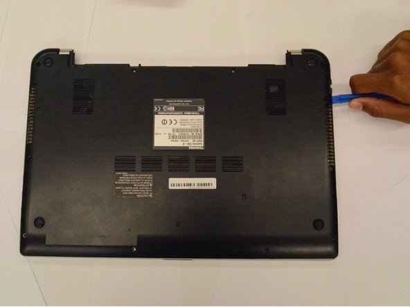 Using the plastic opening tools, open the back cover and remove it from the laptop.