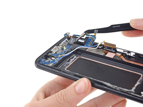 Use tweezers to lift the daughterboard out of the case.