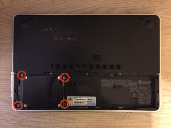 Using a Phillips #0 screwdriver, remove the four 2.0x3.0 mm screws that hold the hard drive compartment in place.