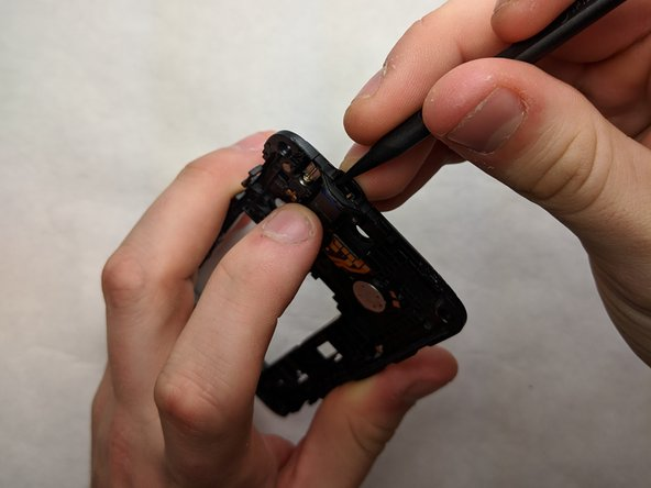 Remove the headphone jack using the spudger to push down on the jack to dislodge it from the phone.