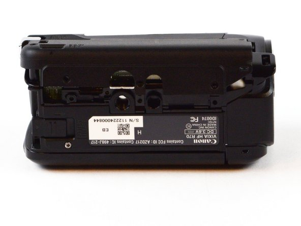 Using your screwdriver, locate and remove the four 6mm Phillips #00 screws connecting the side panel to the bottom of the camcorder.
