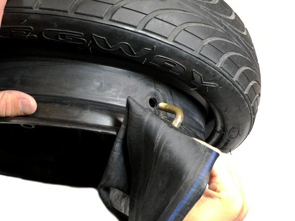 When you are sure you have the correct inner tube, take the nub of the new inner tube and put it back into the hole of the rim that the old inner tube nub was removed from previously.