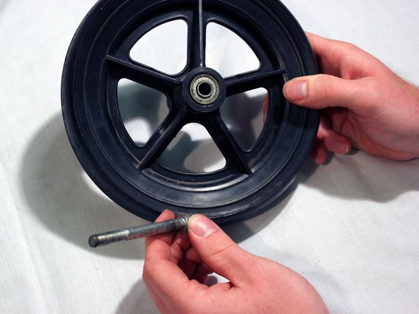 Check for and remove any debris from the wheel or wheel axle that may be obstructing motion of the wheel