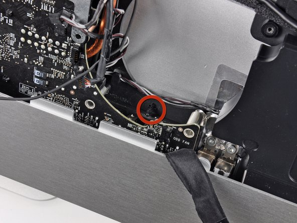 Image 1/1: Be sure the logic board clears the plastic lower optical drive fan mounting pin before lifting it up, as it is easily snapped off.