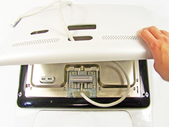 Remove the grey back panel by lifting the bottom and pulling the ADC cable through the hole.